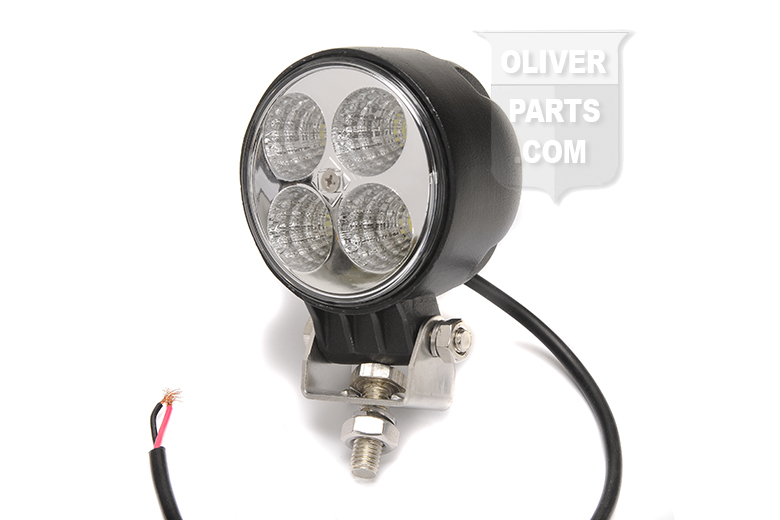 Get the most lumens of output for your buck with our 12v LED flood lamp! This attractive lamp has a metal housing, a flood type reflector, quad LED technology, and really lights the way!  Type: LED, Flood Beam Body Material: Aluminum Lens: Polycarbonate Dimensions: 3.00 Diameter Lumens: 630 Watts: 12 Amps: 1